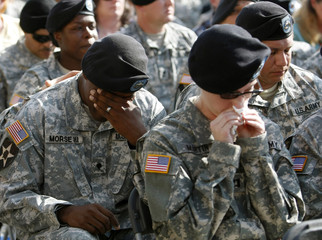 A soldier weeps during a memorial service at Fort Hood in Texas