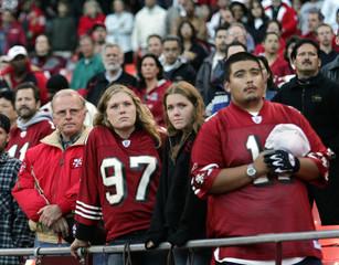 49ers fans watch video honoring former 49er Thoman Herrion in San Francisco.