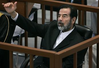 Former Iraqi President Saddam Hussein testifies during his trial in Baghdad