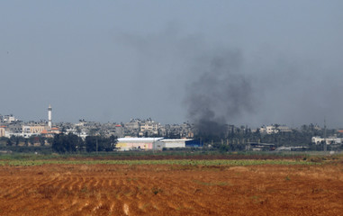 Smoke rises from Gaza seen from Israel's Karni Crossing