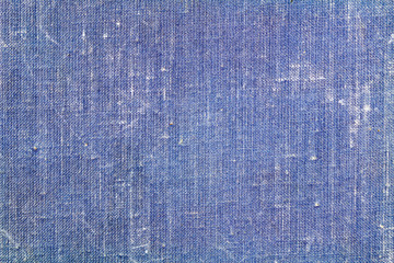 Vintage blue textile texture with fading and scratches. Abstract background