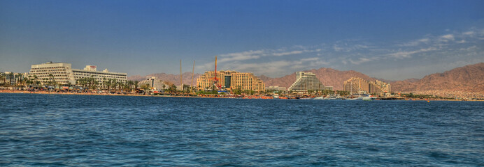 Magnificent panoramic colorful HDR image of the new harbor of Eilat with its beautiful resorts, Israel.
