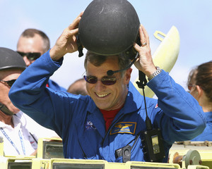 Canadian Space Agency astronaut Dave Williams removes his helmet in Cape Canaveral