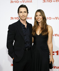 Christian Bale and his wife Sibi Blazic pose at the premiere of 3:10 to Yuma at the Mann National theatre in Westwood