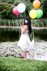 Alice in Wonderland. Girl with dark, long hair with balloons