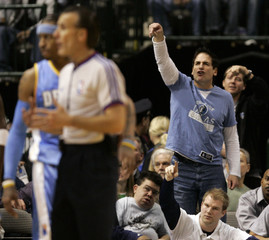 Mavericks owner Cuban shouts at the referee to count the basket after a Maverick was fouled in the first half of their NBA  basketball game against the Nuggets in Dallas