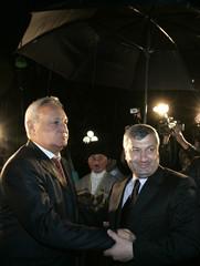 Eduard Kokoity, South Ossetia's regional leader, and Abkhazia's President Sergei Bagapsh shake hands as they meet in Tskhinvali