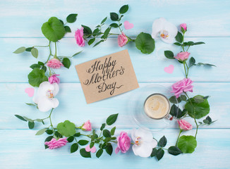 Floral frame consists of roses and orchid flowers and coffee cup with card for Mothers day