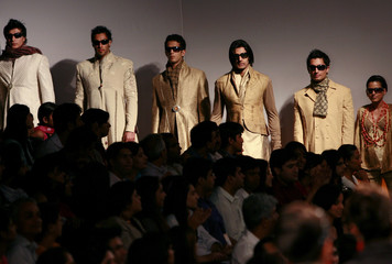 Models present creations by Indian designer Valaya at a fashion show in New Delhi