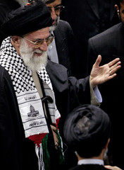 Iran's Supreme Leader Ayatollah Khamenei leaves a conference in Tehran