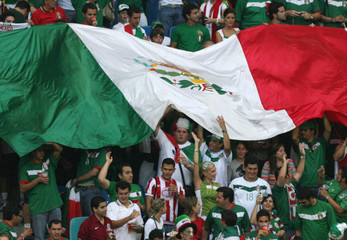 Mexico fans wave a giant flag before the second round World Cup 2006 soccer match between Argentina and Mexico in Leipzig