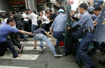 A Filipino student activists clash with anti-riot policemen during a rally in Manila