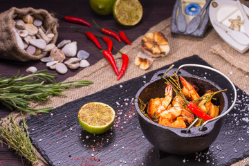 Tiger shrimps, are served with spicy mix from garlic with spices and pepper
