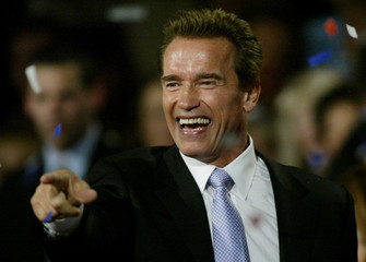 ARNOLD SCHWARZENEGGER GESTURES TO SUPPORTERS IN LOS ANGELES.