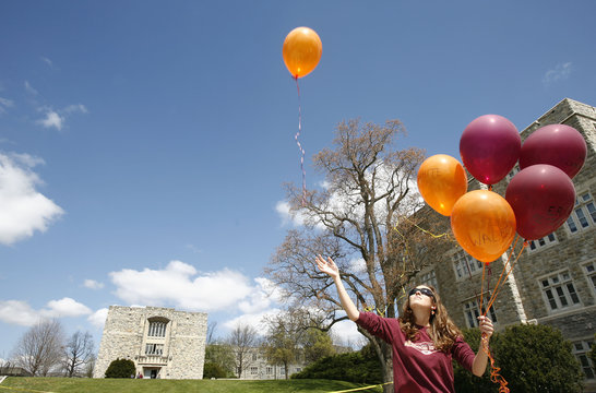 Moore lets balloons go with the names of the victims of the Virginia Tech shootings in front of Norris Hall marking a moment of silence in Blacksburg