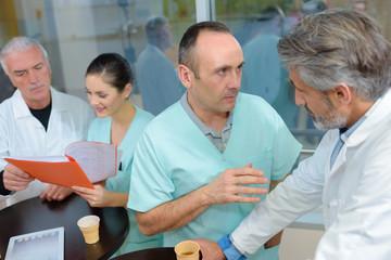 Medical staff talking while on break