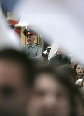 A Kosovo Serb man wearing a Russian uniform attends a protest in the ethnically divided town of Mitrovica