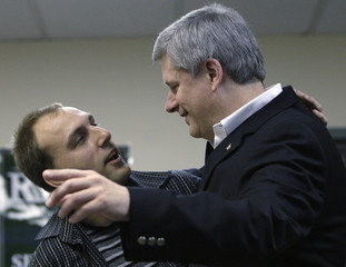 Canadian Prime Minister Stephen Harper shares a joke in Burnaby