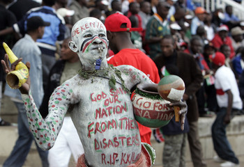 A Kenyan soccer fan poses just before the start of their 2010 World Cup qualifying match Africa zone in Nairobi