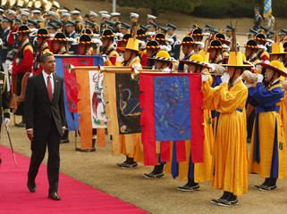 U.S. President Barack Obama takes part in a welcoming ceremony at the Blue House in Seoul