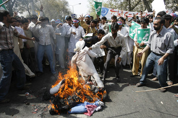 Supporters of Islami Jamiat-e-Talba group burn effigy representing Denmark during rally in Lahore