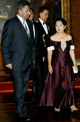 Philippine President Gloria Macapagal Arroyo walks with visiting Pakistan President Pervez ...