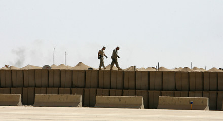 U.S. soldiers inspect the fence to a helipad in the U.S. military's Camp Grizzly in Iraq's Diyala province