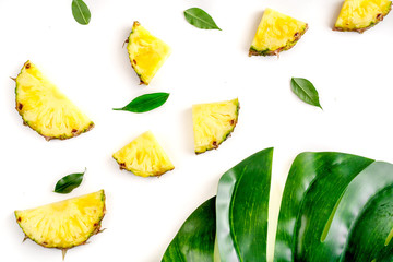 summer dessert with pineapples and leaves on white background top view pattern