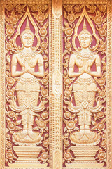 The Carving wood of door at temple in Chiang Mai Thailand