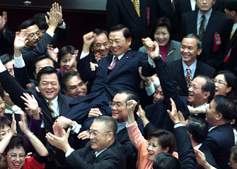 OPPOSITION NATIONALIST LEGISLATORS THROW CHIANG PIN-KUNG INTO AIR INTAIPEI.