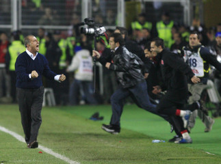 Turkey's head coach Fatih Terim celebrates his team's win over Bosnia in their Euro 2008 Group C qualifying soccer match