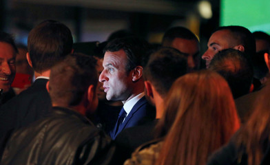 Emmanuel Macron speaks with supporters at a restaurant of Bowling in Rodez