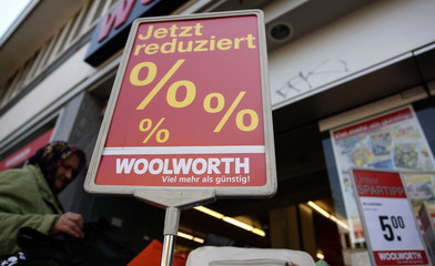 Woman looks for goods at Woolworth shop in Hamburg