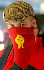 A G8 protestor wears a scarf with the Internationale Socialisten symbol, a Dutch political group, in..