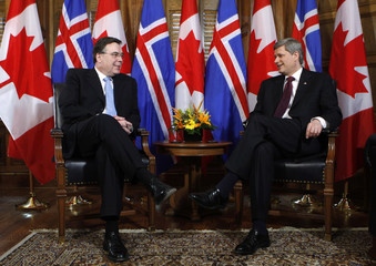 Canada's Prime Minister Harper talks with Iceland's Prime Minister Haarde at the start of their meeting in Ottawa