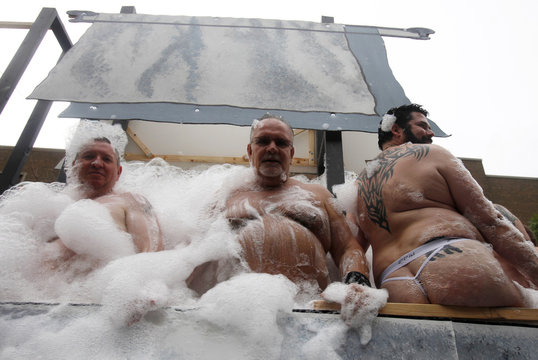 Revellers take part in the annual Gay Pride Parade in a giant bubble bath on a truck in Toronto
