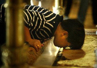 CHRISTIAN WORSHIPPER PRAYS AT THE SITE BELIEVED TO BE WHERE JESUSCHRIST WAS CRUCIFIED.