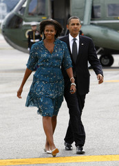 U.S. President Barack Obama and first lady Michelle Obama depart New York for Pittsburgh to attend the G20 Summit