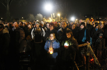 Hundreds of people take part in a silent gathering to pay tribute to the victims of a knife attack in a creche in Dendermonde