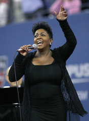 """Anita Baker sings """"America the Beautiful"""" before the start of the women's final at the U.S. Open tennis tournament in New York"""