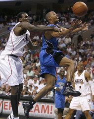 Magic guard Alston is fouled on his way to the basket by Philadelphia 76ers center Dalembert during the first quarter of Game 4 of their NBA Eastern Conference playoff series in Philadelphia
