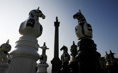Figures from 'The Tournament', a giant chess set designed by Jaime Hayon of Spain, stand among Nelsons Colum in Trafalgar Square in central London