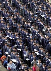Kashmiri students of a missionary school assemble for morning prayers in Srinagar
