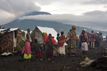 People displaced by fighting gather at a refugee camp at Kibati at the foot of Nyiragongo volcano in eastern Congo