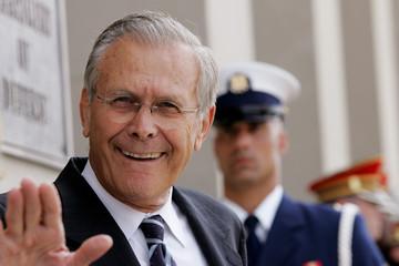 U.S. Secretary of Defense Donald Rumsfeld waves as he waits for Iraqi Prime Minister Nuri al-Maliki at the Pentagon