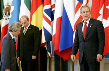 US President Bush poses for a G8 group photo in St Petersburg