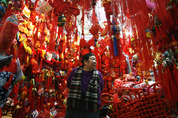 A woman looks at Chinese Lunar New Year decorations at a shop in Beijing