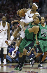 Boston Celtics' Pierce clashes with Cleveland Cavaliers' Gibson during their NBA Eastern Conference semi-final basketball series in Cleveland