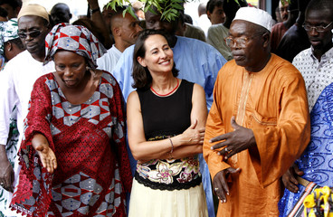 French socialist leader and presidential frontrunner Segolene Royal listens to members of a women's collective during a visit to Thiaroye