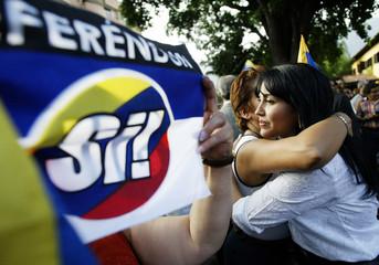 VENEZUELAN OPPOSITION SUPPORTERS CELEBRATE REFERENDUM'S DECISION IN CARACAS.